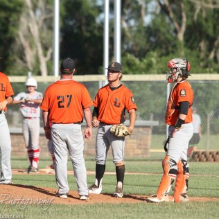 Larned Indian Manager Chad Erway (#27) talks with his team after the Great Bend Chiefs get some runners on base. The Great Bend Chiefs win game 1 of a American Legion baseball double header over the Larned Indians 7 to 6 after 8 innings at the Great Bend Sports Complex in Great Bend, Kansas on June 29, 2016. (Photo: Joey Bahr, www.joeybahr.com)