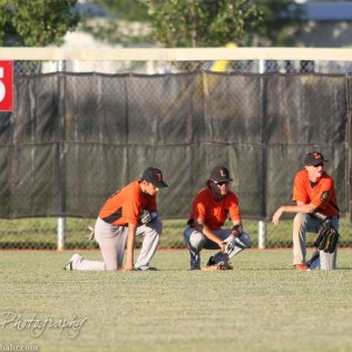 The Larned Indian outfielders take a break as a relief pitcher warms up. The Great Bend Chiefs win game 1 of a American Legion baseball double header over the Larned Indians 7 to 6 after 8 innings at the Great Bend Sports Complex in Great Bend, Kansas on June 29, 2016. (Photo: Joey Bahr, www.joeybahr.com)