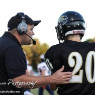 LaCrosse Leopard Head Coach Jon Webster gives the next play to Daniel Schlegel (#20) during the LaCrosse Leopards vs Minneapolis Lions football game with LaCrosse winning 24 to 14 at Bill Schoendaller Athletic Field in LaCrosse, Kansas on September 18, 2015. (Photo: Joey Bahr, www.joeybahr.com)