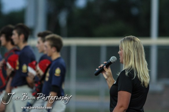 Sherri Duvall sings the National Anthem prior to the start of the game. The Great Bend Braves won their first round game over Doniphan County 14 to 4 in the American Legional Class A Baseball State Tournament at the Great Bend Sports Complex in Great Bend, Kansas on July 20, 2016. (Photo: Joey Bahr, www.joeybahr.com)