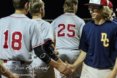 Members of the Great Bend Braves shake the hands of the Doniphan County team following the game. The Great Bend Braves won their first round game over Doniphan County 14 to 4 in the American Legional Class A Baseball State Tournament at the Great Bend Sports Complex in Great Bend, Kansas on July 20, 2016. (Photo: Joey Bahr, www.joeybahr.com)