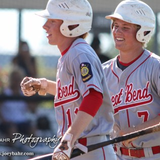 Great Bend Chief Hunter Hanzlick (#7) congratulates Konner Ireland (#11) on scoring in the top of the First Inning. The Great Bend Chiefs won the AAA Lower Zone 1 & 2 Tournament by defeating the Garden City Elite 10 to 4 at Great Bend Sports Complex in Great Bend, Kansas on July 18, 2016. (Photo: Joey Bahr, www.joeybahr.com)
