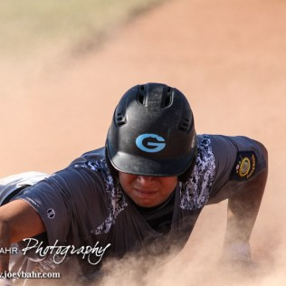 Garden City Elite Orlando Hernandez (#13) dives back for First Base in the bottom of the Second Inning. The Great Bend Chiefs won the AAA Lower Zone 1 & 2 Tournament by defeating the Garden City Elite 10 to 4 at Great Bend Sports Complex in Great Bend, Kansas on July 18, 2016. (Photo: Joey Bahr, www.joeybahr.com)
