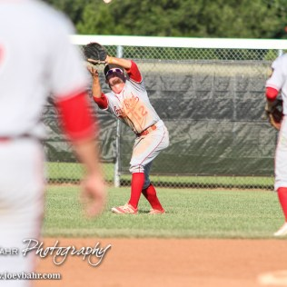 Great Bend Chief Payton Mauler (#12) bends over to catch a fly ball in the bottom of the Fourth Inning. The Great Bend Chiefs won the AAA Lower Zone 1 & 2 Tournament by defeating the Garden City Elite 10 to 4 at Great Bend Sports Complex in Great Bend, Kansas on July 18, 2016. (Photo: Joey Bahr, www.joeybahr.com)