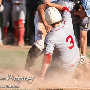 Garden City Elite Sloan Baker (#33) tags Great Bend Chief Jaxx Hillman (#3) out at home plate as he tried to score on a wild pitch. The Great Bend Chiefs won the AAA Lower Zone 1 & 2 Tournament by defeating the Garden City Elite 10 to 4 at Great Bend Sports Complex in Great Bend, Kansas on July 18, 2016. (Photo: Joey Bahr, www.joeybahr.com)