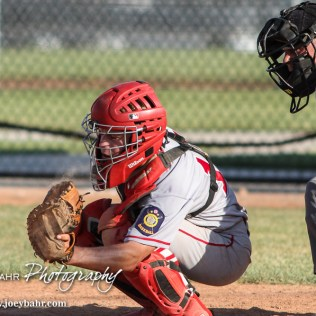Great Bend Chief Anson Hall (#14) catches a pitch. The Great Bend Chiefs won the AAA Lower Zone 1 & 2 Tournament by defeating the Garden City Elite 10 to 4 at Great Bend Sports Complex in Great Bend, Kansas on July 18, 2016. (Photo: Joey Bahr, www.joeybahr.com)