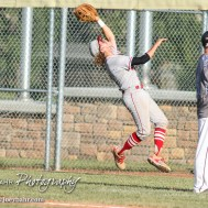 Great Bend Chief Jared Maneth (#17) jumps to catch a fly ball in foul territory. The Great Bend Chiefs won the AAA Lower Zone 1 & 2 Tournament by defeating the Garden City Elite 10 to 4 at Great Bend Sports Complex in Great Bend, Kansas on July 18, 2016. (Photo: Joey Bahr, www.joeybahr.com)