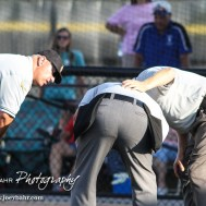 Umpires check on the Home Plate umpire after he to a ball off his body in the bottom of the Sixth Inning. The Great Bend Chiefs won the AAA Lower Zone 1 & 2 Tournament by defeating the Garden City Elite 10 to 4 at Great Bend Sports Complex in Great Bend, Kansas on July 18, 2016. (Photo: Joey Bahr, www.joeybahr.com)