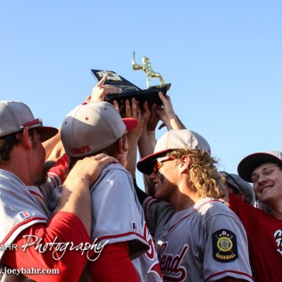 The Great Bend Chiefs hold up the Zone Tournament Trophy. The Great Bend Chiefs won the AAA Lower Zone 1 & 2 Tournament by defeating the Garden City Elite 10 to 4 at Great Bend Sports Complex in Great Bend, Kansas on July 18, 2016. (Photo: Joey Bahr, www.joeybahr.com)