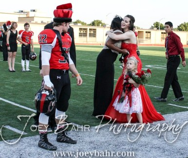 Past Queen Michaela Johnson hugs 2016 Queen Kate Warren during the Homecoming Festivities prior to the game. The Great Bend Panthers defeated the Dodge City Demons 34 to 27 at Memorial Stadium in Great Bend, Kansas on September 23, 2016. (Photo: Joey Bahr, www.joeybahr.com)