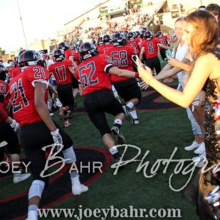 The Great Bend Panthers run onto the field while greeting their fans. The Great Bend Panthers defeated the Dodge City Demons 34 to 27 at Memorial Stadium in Great Bend, Kansas on September 23, 2016. (Photo: Joey Bahr, www.joeybahr.com)