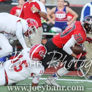 Dodge City Demons Samuel Unruh (#1) and Payson Hatfield (#15) try to bring down Great Bend Panther Bryce Lytle (#20). The Great Bend Panthers defeated the Dodge City Demons 34 to 27 at Memorial Stadium in Great Bend, Kansas on September 23, 2016. (Photo: Joey Bahr, www.joeybahr.com)