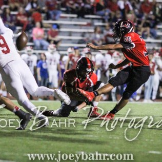 Great Bend Panther Carlos Franco (#38) kicks a Point After Touchdown as Koy Brack (#12) holds. The Great Bend Panthers defeated the Dodge City Demons 34 to 27 at Memorial Stadium in Great Bend, Kansas on September 23, 2016. (Photo: Joey Bahr, www.joeybahr.com)