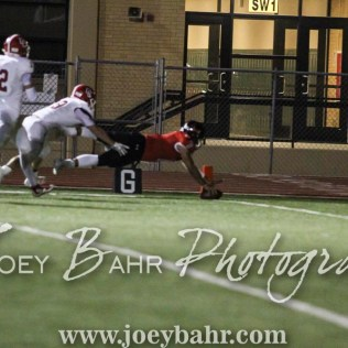 Great Bend Panther Jacob Murray (#7) dives for the goal line to score a touchdown. The Great Bend Panthers defeated the Dodge City Demons 34 to 27 at Memorial Stadium in Great Bend, Kansas on September 23, 2016. (Photo: Joey Bahr, www.joeybahr.com)