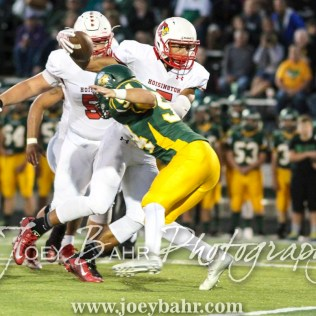 Hoisington Cardinal Cameron Davis (#5) swims over Pratt Greenback Jackson Bailey (#54). The Hoisington Cardinals defeated the Pratt Greenbacks 32 to 14 at Zerger Field in Pratt, Kansas on September 30, 2016. (Photo: Joey Bahr, www.joeybahr.com)