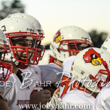 The Hoisington Cardinal sideline celebrates the scoring of a touchdown. The Hoisington Cardinals defeated the Pratt Greenbacks 32 to 14 at Zerger Field in Pratt, Kansas on September 30, 2016. (Photo: Joey Bahr, www.joeybahr.com)