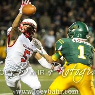 Hoisington Cardinal Cameron Davis (#5) breaks up a pass intended for Pratt Greenback Hunter Kaufman (#1). The Hoisington Cardinals defeated the Pratt Greenbacks 32 to 14 at Zerger Field in Pratt, Kansas on September 30, 2016. (Photo: Joey Bahr, www.joeybahr.com)