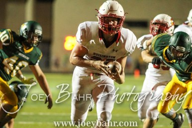 Hoisington Cardinal Hunter Hanzlick (#27) carries the ball to score a touchdown. The Hoisington Cardinals defeated the Pratt Greenbacks 32 to 14 at Zerger Field in Pratt, Kansas on September 30, 2016. (Photo: Joey Bahr, www.joeybahr.com)