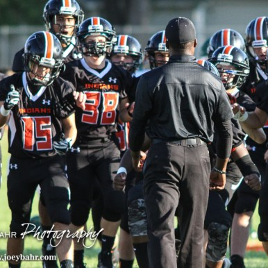 The Larned Indians run to their Head Coach AB Stokes before the game. The Pratt Greenbacks win 31 to 16 over the Larned Indians at Earl Roberts Field in Larned, Kansas on September 2, 2016. (Photo: Joey Bahr, www.joeybahr.com)