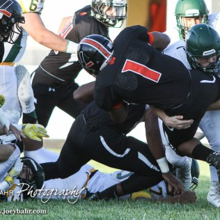 Pratt Greenback Travis Theis (#5) tackles Larned Indian Anthony McConnell (#1). The Pratt Greenbacks win 31 to 16 over the Larned Indians at Earl Roberts Field in Larned, Kansas on September 2, 2016. (Photo: Joey Bahr, www.joeybahr.com)