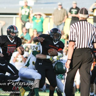 Pratt Greenback Logan Baird (#34) ends Larned Indian Anthony McConnell's (#1) rush. The Pratt Greenbacks win 31 to 16 over the Larned Indians at Earl Roberts Field in Larned, Kansas on September 2, 2016. (Photo: Joey Bahr, www.joeybahr.com)