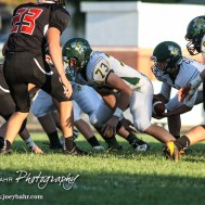 Pratt Greenback Justin Lamatsch (#73) hikes the ball to Landen Studer (#6). The Pratt Greenbacks win 31 to 16 over the Larned Indians at Earl Roberts Field in Larned, Kansas on September 2, 2016. (Photo: Joey Bahr, www.joeybahr.com)