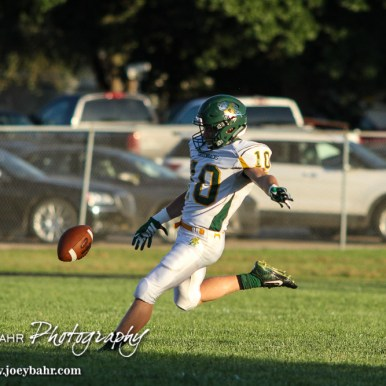 Pratt Greenback Noah Myers (#10) punts the ball in the First Quarter. The Pratt Greenbacks win 31 to 16 over the Larned Indians at Earl Roberts Field in Larned, Kansas on September 2, 2016. (Photo: Joey Bahr, www.joeybahr.com)