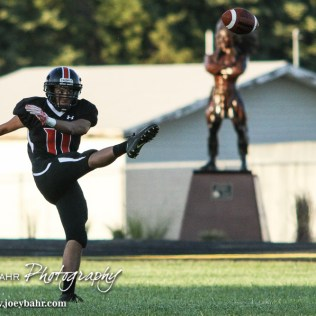 Larned Indian David Valadez (#11) punts the ball. The Pratt Greenbacks win 31 to 16 over the Larned Indians at Earl Roberts Field in Larned, Kansas on September 2, 2016. (Photo: Joey Bahr, www.joeybahr.com)