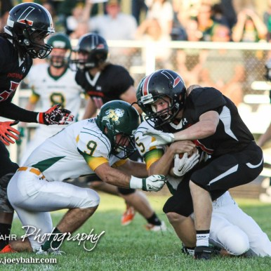 Pratt Greenback Travis Theis (#5) tackles Larned Indian Kolby Keith (#4). The Pratt Greenbacks win 31 to 16 over the Larned Indians at Earl Roberts Field in Larned, Kansas on September 2, 2016. (Photo: Joey Bahr, www.joeybahr.com)