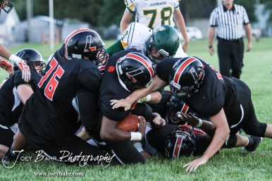 The Larned Indians swarm around Nate Williams (#34) as he converts a two point play. The Pratt Greenbacks win 31 to 16 over the Larned Indians at Earl Roberts Field in Larned, Kansas on September 2, 2016. (Photo: Joey Bahr, www.joeybahr.com)