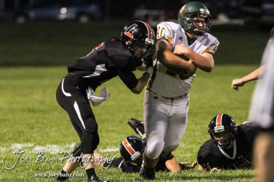 Larned Indian Carson Smith (#5) tries to tackle Pratt Greenback Hunter Huber (#40). The Pratt Greenbacks win 31 to 16 over the Larned Indians at Earl Roberts Field in Larned, Kansas on September 2, 2016. (Photo: Joey Bahr, www.joeybahr.com)