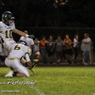 Pratt Greenback Noah Myers (#10) kicks a Point After Touchdown as Landen Studer (#6) holds. The Pratt Greenbacks win 31 to 16 over the Larned Indians at Earl Roberts Field in Larned, Kansas on September 2, 2016. (Photo: Joey Bahr, www.joeybahr.com)