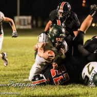 Pratt Greenback Travis Theis (#5) stretches the football for extra yardage. The Pratt Greenbacks win 31 to 16 over the Larned Indians at Earl Roberts Field in Larned, Kansas on September 2, 2016. (Photo: Joey Bahr, www.joeybahr.com)