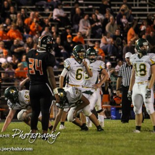 Pratt Greenback Landen Studer (#6) and the rest of the offense looks for a corrected play from the coaches. The Pratt Greenbacks win 31 to 16 over the Larned Indians at Earl Roberts Field in Larned, Kansas on September 2, 2016. (Photo: Joey Bahr, www.joeybahr.com)