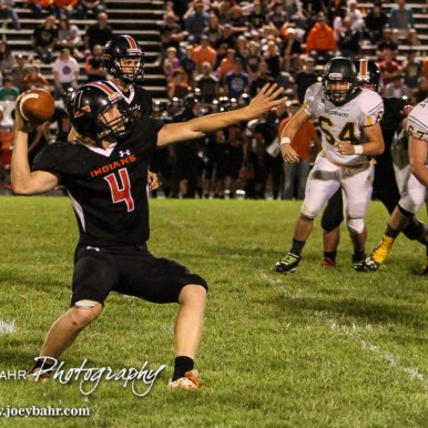 Larned Indian Kolby Keith (#4) stops to throw a deep pass. The Pratt Greenbacks win 31 to 16 over the Larned Indians at Earl Roberts Field in Larned, Kansas on September 2, 2016. (Photo: Joey Bahr, www.joeybahr.com)