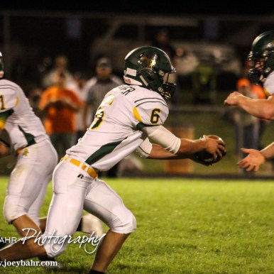 Pratt Greenback Landen Studer (#6) hands the ball off to Travis Theis (#5) in the backfield. The Pratt Greenbacks win 31 to 16 over the Larned Indians at Earl Roberts Field in Larned, Kansas on September 2, 2016. (Photo: Joey Bahr, www.joeybahr.com)