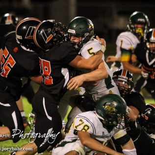 Larned Indian Hunter Barker (#28) stands up Pratt Greenback Travis Theis (#5). The Pratt Greenbacks win 31 to 16 over the Larned Indians at Earl Roberts Field in Larned, Kansas on September 2, 2016. (Photo: Joey Bahr, www.joeybahr.com)