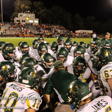 Pratt Greenback Head Coach Jamie Cruce breaks down his team after the game. The Pratt Greenbacks win 31 to 16 over the Larned Indians at Earl Roberts Field in Larned, Kansas on September 2, 2016. (Photo: Joey Bahr, www.joeybahr.com)