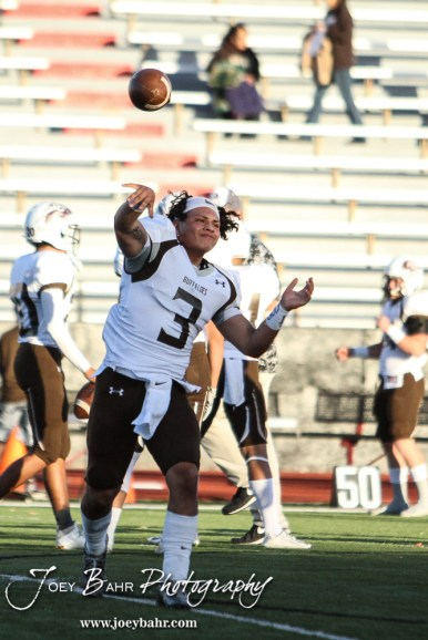 Garden City Buffalo Jesse Nunez (#3) throws a pass during warmups. The Garden City Buffaloes defeated the Great Bend Panthers 21 to 14 in Overtime to win the Western Athletic Conference title at Memorial Stadium in Great Bend, Kansas on October 21, 2016. (Photo: Joey Bahr, www.joeybahr.com)