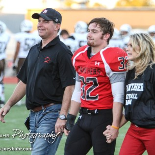 Great Bend Panther Payton Mauler (#32) is introduced along with his parents during the Parents Night Ceremony before the game. The Garden City Buffaloes defeated the Great Bend Panthers 21 to 14 in Overtime to win the Western Athletic Conference title at Memorial Stadium in Great Bend, Kansas on October 21, 2016. (Photo: Joey Bahr, www.joeybahr.com)