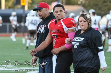 Great Bend Panther Jacob Murray (#7) is introduced along with his parents during the Parents Night Ceremony before the game. The Garden City Buffaloes defeated the Great Bend Panthers 21 to 14 in Overtime to win the Western Athletic Conference title at Memorial Stadium in Great Bend, Kansas on October 21, 2016. (Photo: Joey Bahr, www.joeybahr.com)