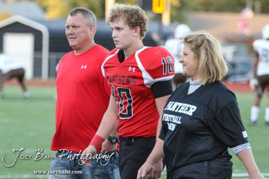 Great Bend Panther Jensen Randall (#10) is introduced along with his parents during the Parents Night Ceremony before the game. The Garden City Buffaloes defeated the Great Bend Panthers 21 to 14 in Overtime to win the Western Athletic Conference title at Memorial Stadium in Great Bend, Kansas on October 21, 2016. (Photo: Joey Bahr, www.joeybahr.com)