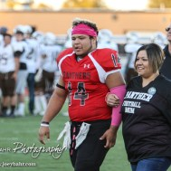 Great Bend Panther Dominique Rideaux (#14) is introduced along with his parents during the Parents Night Ceremony before the game. The Garden City Buffaloes defeated the Great Bend Panthers 21 to 14 in Overtime to win the Western Athletic Conference title at Memorial Stadium in Great Bend, Kansas on October 21, 2016. (Photo: Joey Bahr, www.joeybahr.com)