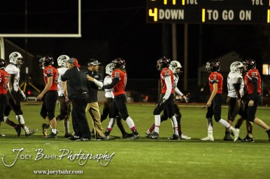 Members of the Garden City Buffaloes and Great Bend Panthers shake hands following the game. The Garden City Buffaloes defeated the Great Bend Panthers 21 to 14 in Overtime to win the Western Athletic Conference title at Memorial Stadium in Great Bend, Kansas on October 21, 2016. (Photo: Joey Bahr, www.joeybahr.com)