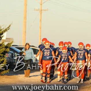 The Otis-Bison Cougars march towards the field. The Otis-Bison Cougars defeated the Greeley County Jackrabbits 62 to 6 at Cougar Field in Otis, Kansas on October 7, 2016. (Photo: Joey Bahr, www.joeybahr.com)