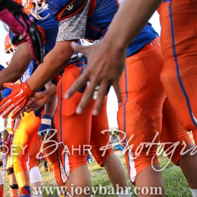 Otis-Bison Cougar Kade Urban (#10) slaps hands of teammates during player introductions. The Otis-Bison Cougars defeated the Greeley County Jackrabbits 62 to 6 at Cougar Field in Otis, Kansas on October 7, 2016. (Photo: Joey Bahr, www.joeybahr.com)