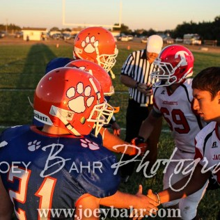 Team captains shake hands prior to the start of the game. The Otis-Bison Cougars defeated the Greeley County Jackrabbits 62 to 6 at Cougar Field in Otis, Kansas on October 7, 2016. (Photo: Joey Bahr, www.joeybahr.com)