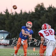 Otis-Bison Cougar Kade Urban (#10) throws a pass. The Otis-Bison Cougars defeated the Greeley County Jackrabbits 62 to 6 at Cougar Field in Otis, Kansas on October 7, 2016. (Photo: Joey Bahr, www.joeybahr.com)