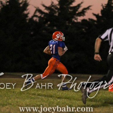 Otis-Bison Cougar Brad Lightfoot (#21) runs for the end zone. The Otis-Bison Cougars defeated the Greeley County Jackrabbits 62 to 6 at Cougar Field in Otis, Kansas on October 7, 2016. (Photo: Joey Bahr, www.joeybahr.com)