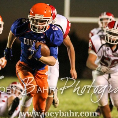 Otis-Bison Cougar Blake Bahr (#7) breaks away from the line of scrimmage. The Otis-Bison Cougars defeated the Greeley County Jackrabbits 62 to 6 at Cougar Field in Otis, Kansas on October 7, 2016. (Photo: Joey Bahr, www.joeybahr.com)